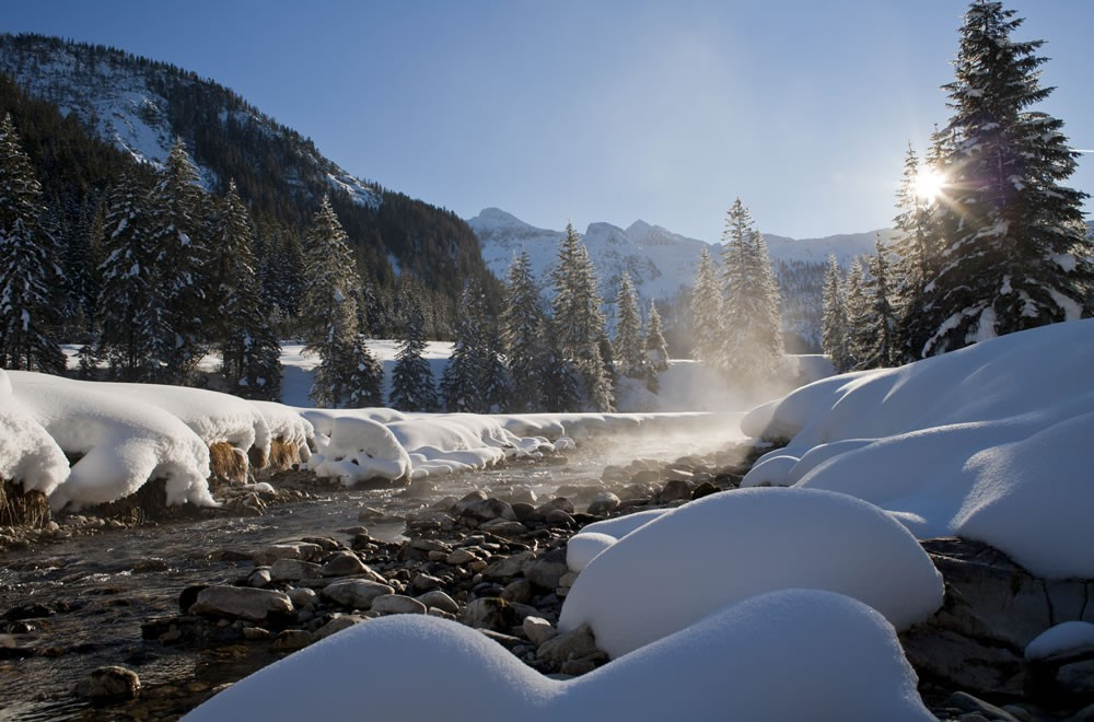 Winter landscape with stream in Obertauern